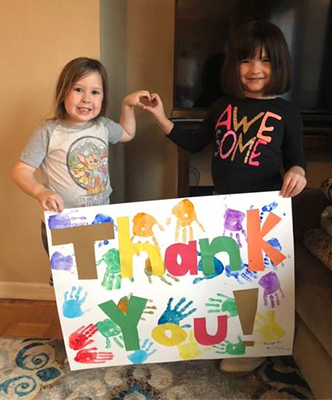 Cecelia and Aridalay proudly display their thank you card.