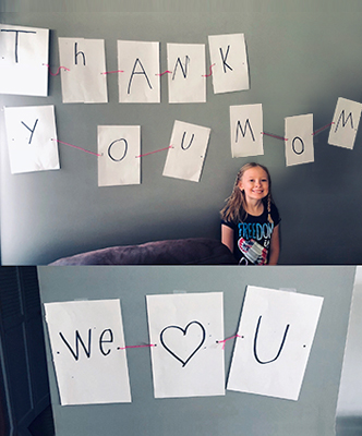 "Kylie's wall art reads ""Thank you mom, we love you."""