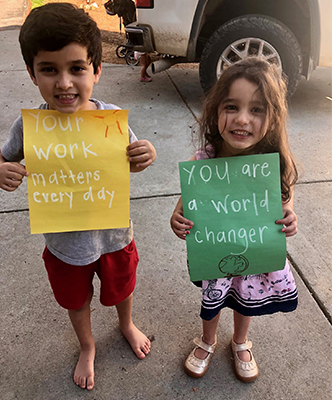 "Max and Nina's letters read ""Your work matters everyday,"" and ""You are a world changer."""